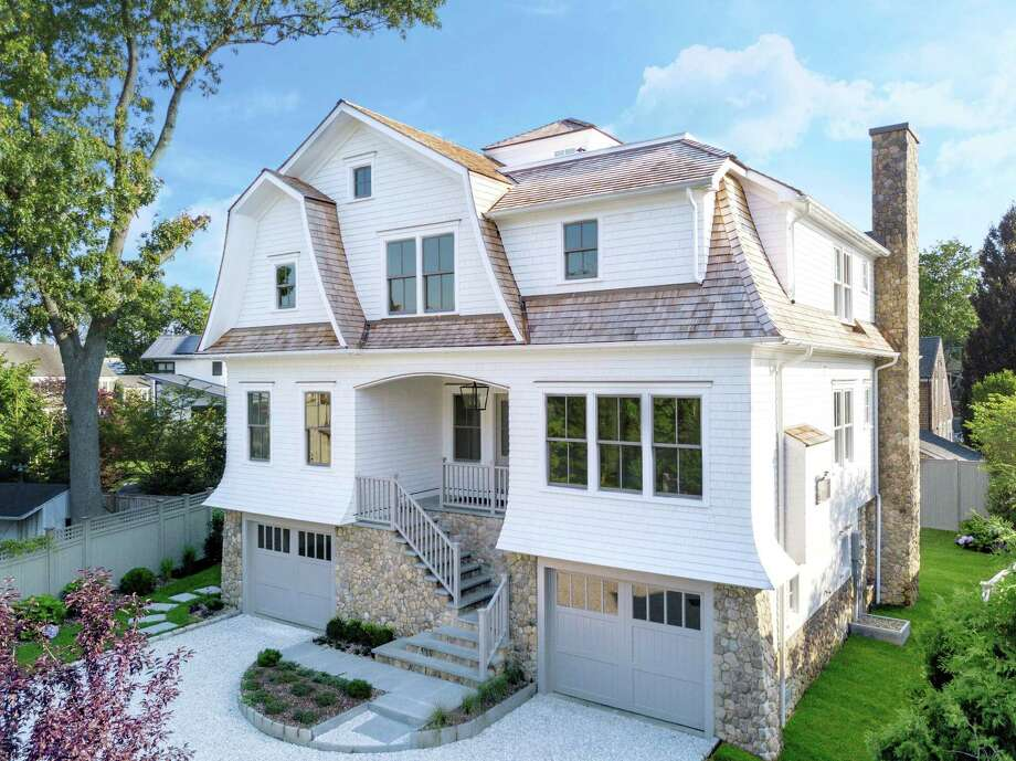 The newly constructed shingle and stone colonial house at 28 Norwalk Ave. is in the Compo Beach neighborhood only two blocks from the beach. Photo: /