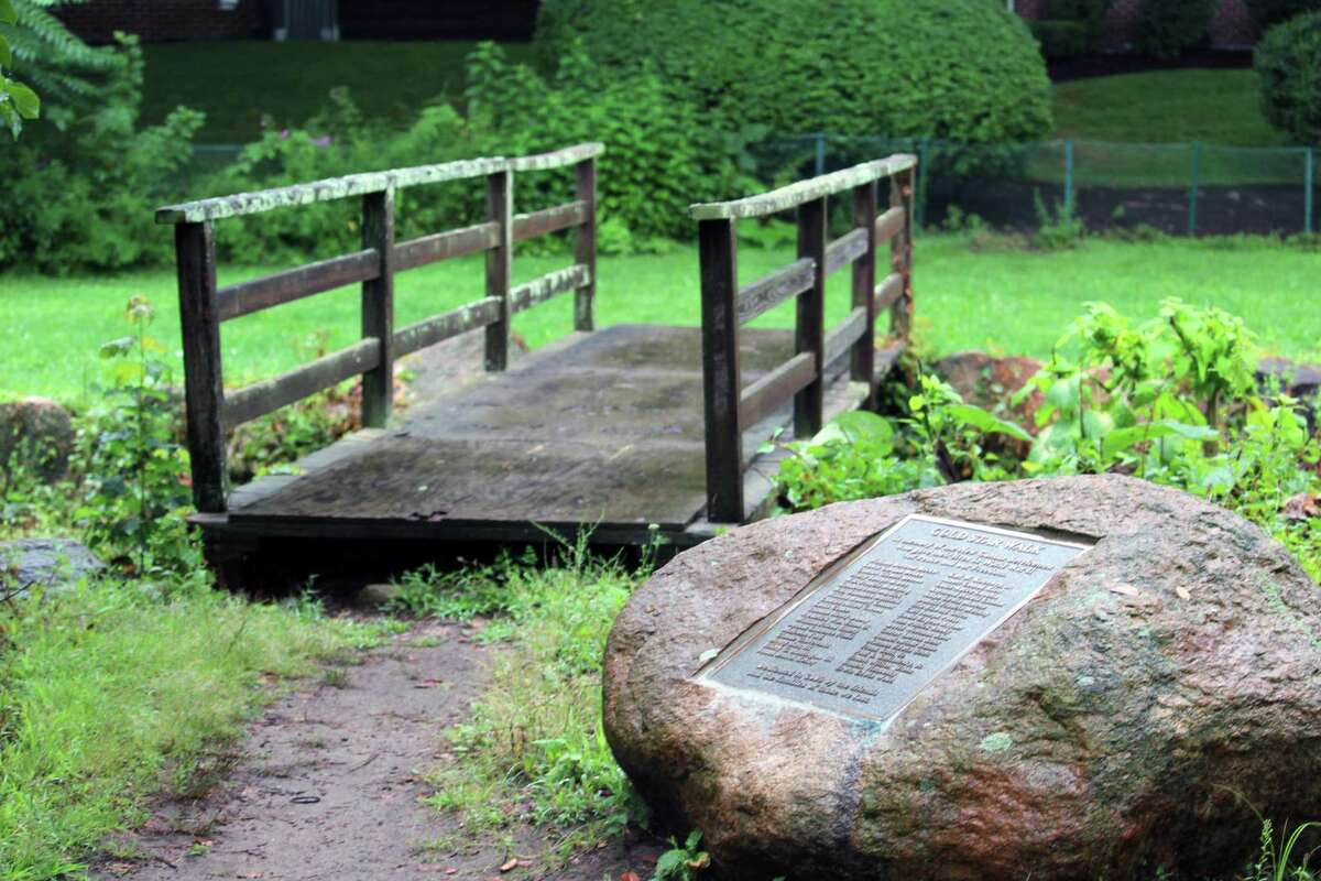 The plaque and old bridge, part of the Gold Star Walk in Mead Park, memorializing World War II veterans in New Canaan on Aug. 18.