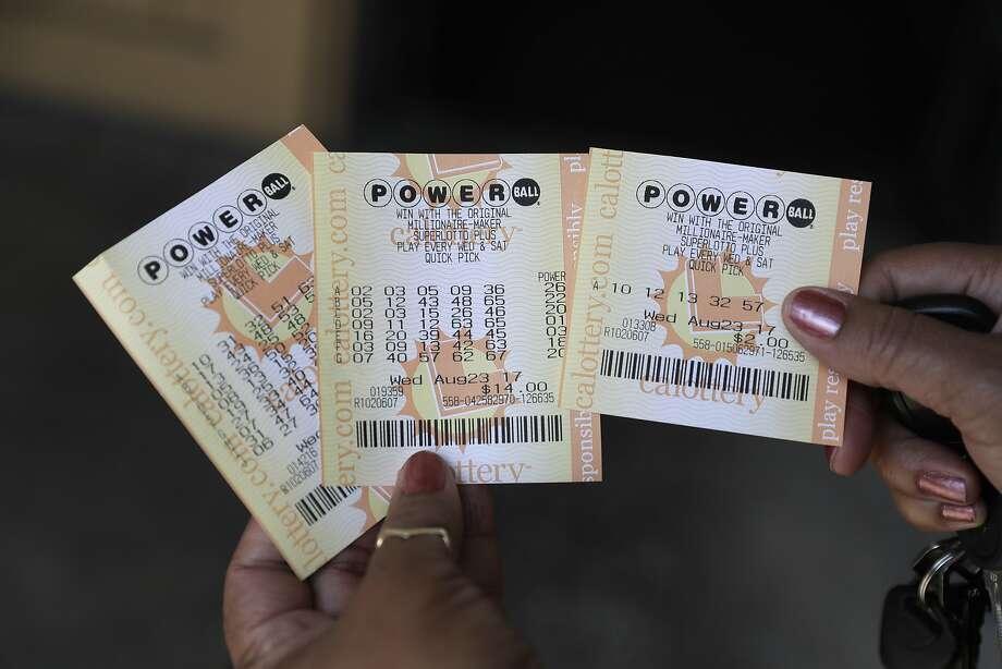 As ofWednesday morning, theMega Millionsjackpot climbed to an estimated $418 million. ThePowerballjackpot reached $440 million. Photo: Marcio Jose Sanchez, Associated Press