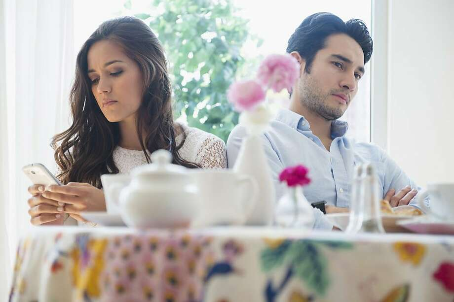 A couple is having issues about where they want to live. Photo: JGI/Jamie Grill, Getty Images/Blend Images