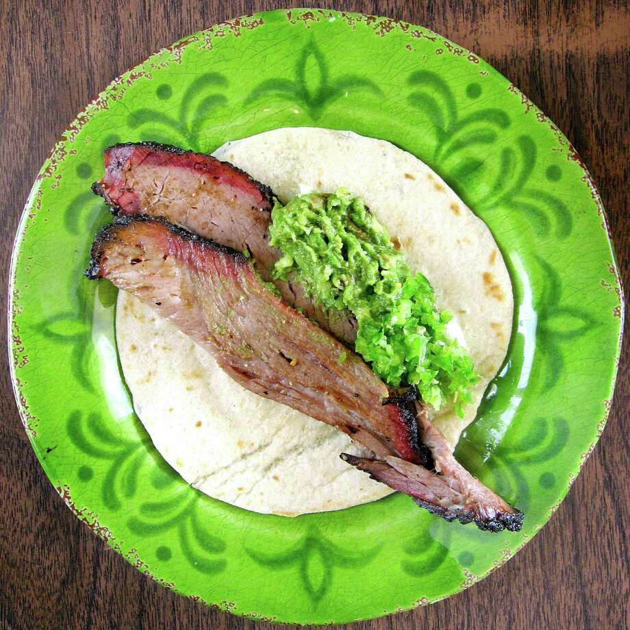 Brisket taco with guacamole on a handmade flour tortilla from Garcia's Mexican Food on Fredericksburg Road. Photo: Mike Sutter /San Antonio Express-News
