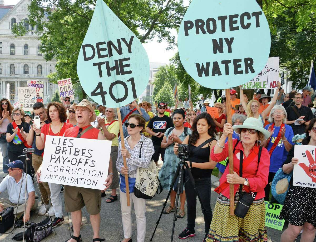 Opponents rally in West Capitol Park to oppose final permitting of the Competitive Power Ventures (CPV) fracked gas plant in Orange County Thursday August 10, 2017 in Albany, NY. (John Carl D'Annibale / Times Union) ORG XMIT: MER2017081013435246