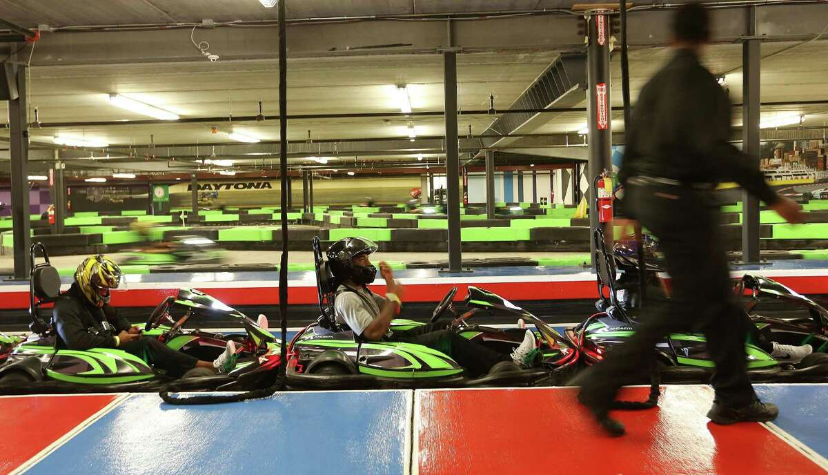 Members of University of Houston's football team get ready to race go carts at Andretti Indoor Karting and Games Monday, Dec. 28, 2015, in Marietta. Andretti plans to open a San Antonio location in summer 2018.
