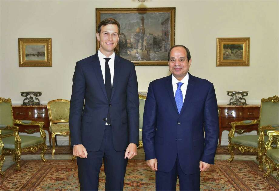 In this photo provided by Egypt's state news agency, MENA, Egypt's President Abdel-Fattah el-Sissi, right, poses for a photo with White House adviser Jared Kushner, in Cairo, Egypt, Wednesday, Aug. 23, 2017. El-Sissi and Egypt's foreign minister have met with Kushner just hours after the Trump administration cut or delayed hundreds of millions of dollars in aid to Cairo over human rights concerns. Kushner, who is also President Donald Trump's son-in-law, was in Cairo as part of a Middle East tour aimed at exploring ways to revive Israeli-Palestinian peace talks, which last collapsed in 2014. (MENA via AP) Photo: Associated Press / MENA
