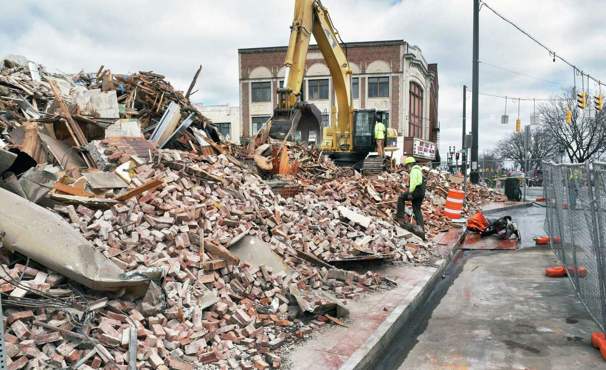 Overnight emergency demolition of the Nicholaus building wraps up at the corner of State Street in April 2017 in Schenectady. (Times Union file)