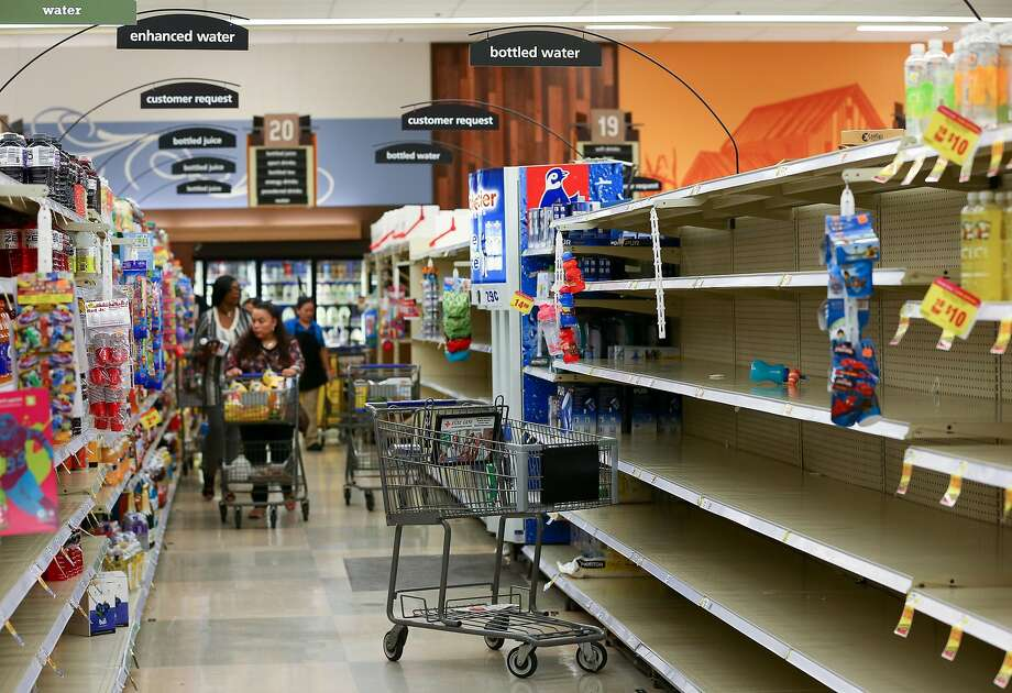 Costumers found empty shelves on the bottled water section inside the Kroger on Buffalo Speedway in preparation of tropical storm Harvey Thursday, Aug. 24, 2017, in Houston. The Kroger store is expecting truckloads of water later today. The storm is estimated to make landfall Friday. ( Godofredo A. Vasquez / Houston Chronicle ) Photo: Godofredo A. Vasquez