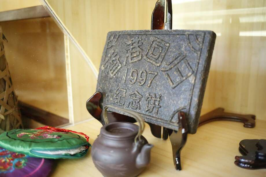 At David Lee Hoffman's Tea Museum, a pressed puer brick (center) and silk-wrapped puer cakes (far left) are on display. Photo: Nicole Boliaux, The Chronicle