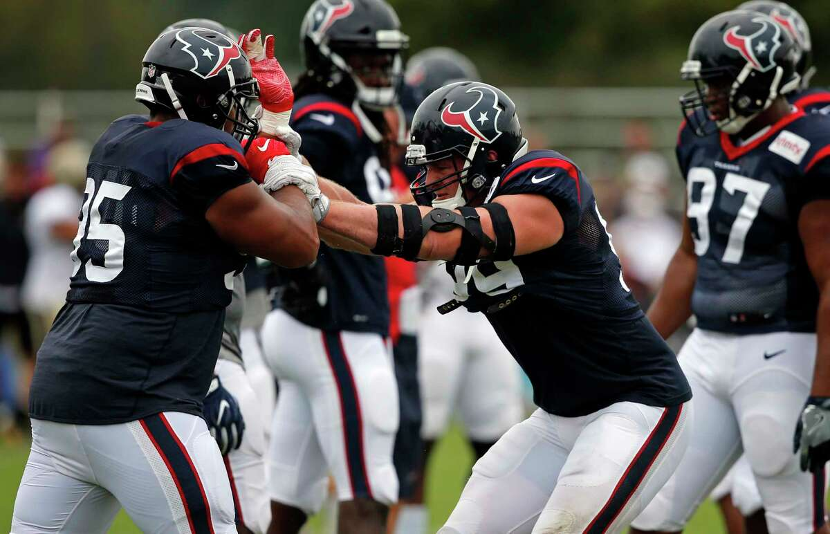 Houston Texans defensive end J.J. Watt right, goes through drills during a joint practice with the New Orleans Saints at the Saints NFL football training facility in Metairie, La., Thursday, Aug. 24, 2017. (AP Photo/Gerald Herbert)