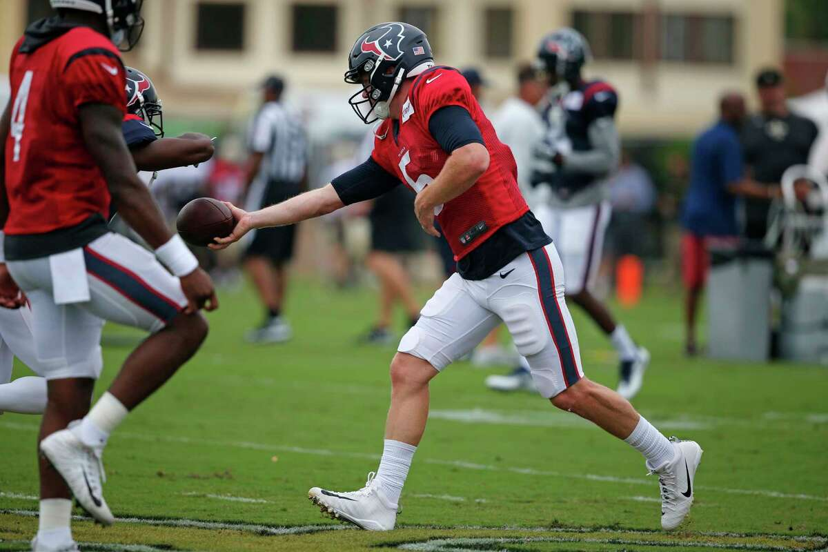 Houston Texans quarterback Brandon Weeden (5) hands off during a joint practice with the New Orleans Saints at the Saints NFL football training facility in Metairie, La., Thursday, Aug. 24, 2017. (AP Photo/Gerald Herbert)