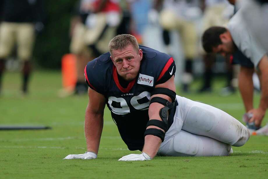 Houston Texans defensive end J.J. Watt (99), center, stretches during a joint practice with the New Orleans Saints at the Saints NFL football training facility in Metairie, La., Thursday, Aug. 24, 2017. (AP Photo/Gerald Herbert) Photo: Gerald Herbert, Associated Press / Copyright 2017 The Associated Press. All rights reserved.