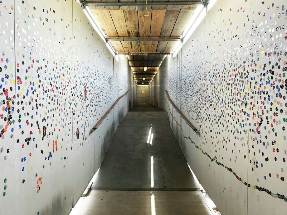 "Both sides of the construction tunnel walkway at the Glassell School of Art have become an evolving ""art installation."" Photo: Molly Glentzer, Houston Chronicle"