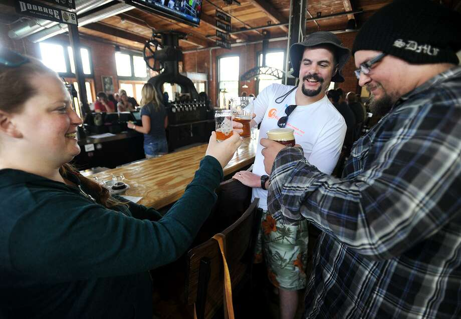 From left, Katie and Eric Tuttle, of Seymour, and Tim Davis, of Ansonia, enjoy a beer at the Bad Sons Brewery at 251 Roosevelt Drive in Derby. The brewery, which opened for business on July 19, is open from Wednesday to Sunday. Photo: Brian A. Pounds / Hearst Connecticut Media / Connecticut Post