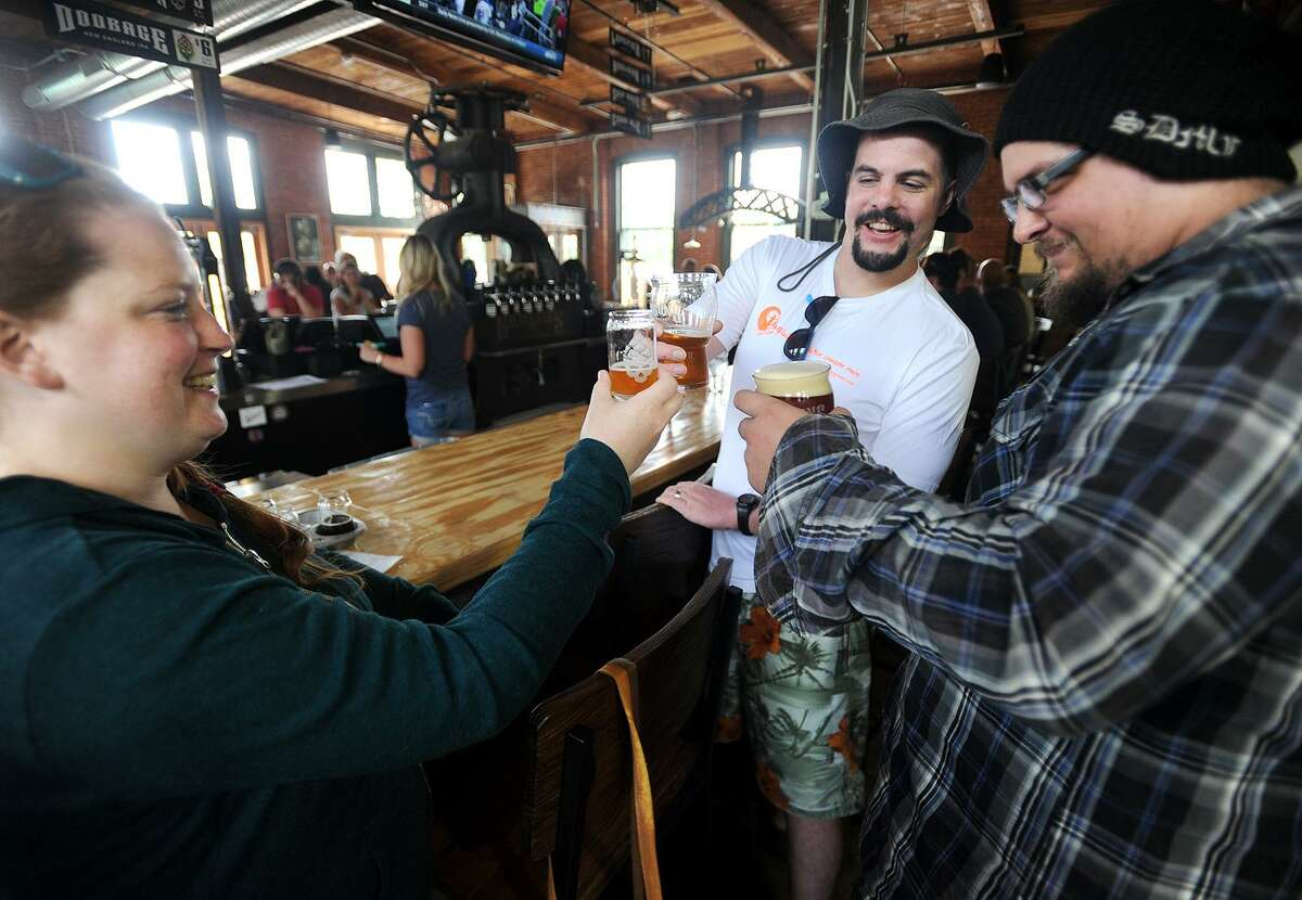From left, Katie and Eric Tuttle, of Seymour, and Tim Davis, of Ansonia, enjoy a beer at the Bad Sons Brewery at 251 Roosevelt Drive in Derby. The brewery, which opened for business on July 19, is open from Wednesday to Sunday.