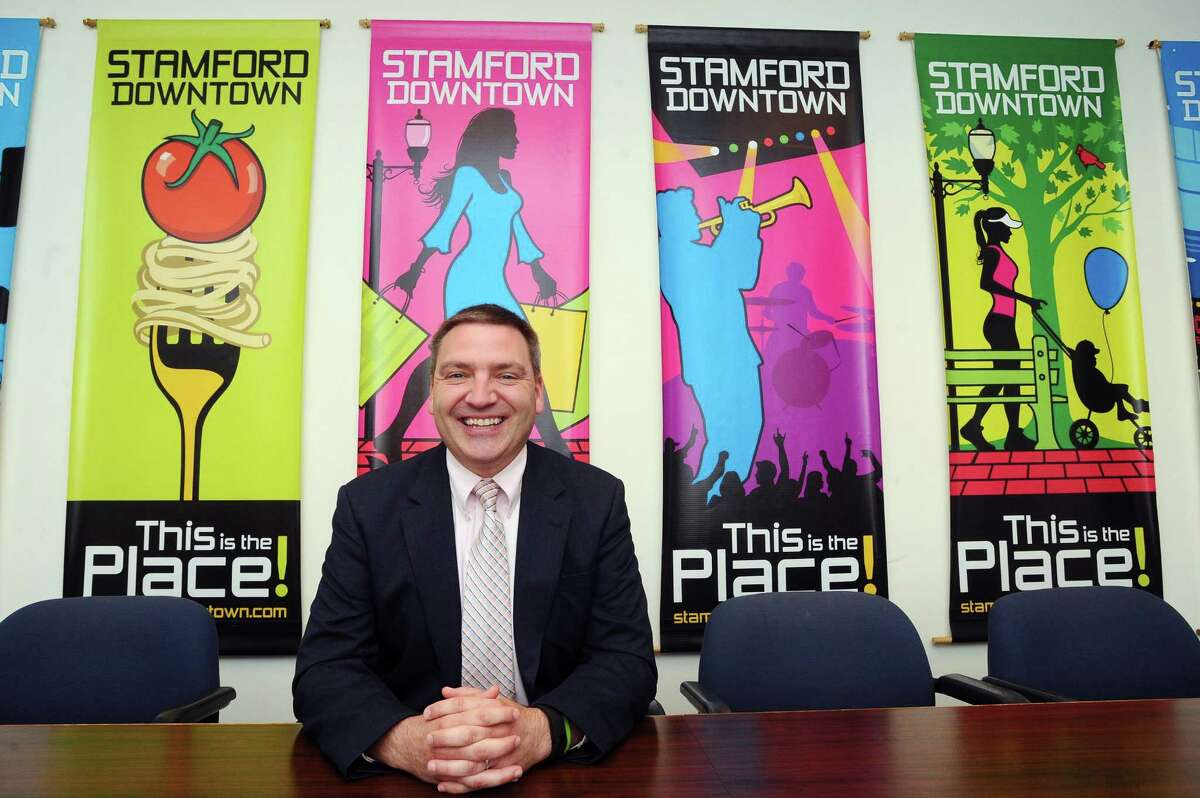 New Stamford Downtown Vice President of Operations Michael Moore poses for a photo inside Stamford Downtown's Landmark Square offices in Stamford, Conn., on Tuesday, August 22, 2017.