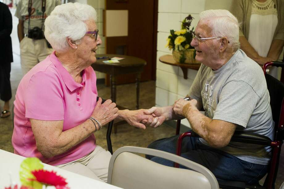 Betty June Jacobs of Midland, 92, left, and Charles Longsdorf of Midland, 83, right, greet one another during a birthday party for Jacobs and four of her relatives, all above the age of 91, on Thursday, August 17, 2017 at Poseyville Methodist Church. Photo: (Katy Kildee/kkildee@mdn.net)