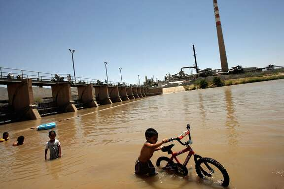 Border Patrol Agents Monitor US-Mexico Border SUNLAND PARK, NM - JUNE 26: With temperatures expected to reach 105-degrees, a young boy pushes his bicycle out of the Rio Grande after taking a swim with his family where New Mexico, Texas and Mexico all touch June 26, 2007 in Sunland Park, New Mexico. According to Majority Leader Harry Reid (D-NV), the Senate took a step closer to passing comprehensive immigration legislation today that could possibly grant 12 million people living in the United States 'a pathway to legalization.' (Photo by Chip Somodevilla/Getty Images) Restrictions Restrictions: Contact your local office for all commercial or promotional uses. Full editorial rights UK, US, Ireland, Canada (not Quebec). Restricted editorial rights for daily newspapers elsewhere, please call. Details Credit: Chip Somodevilla / Staff