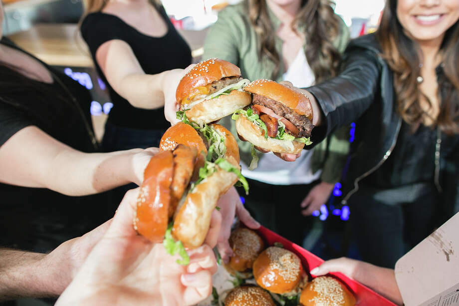 Burgerim, a mini-burger franchise, has opened at 9945 Barker Cypress Road, at the Boardwalk at Towne Lake in Cypress. Photo: Burgerim