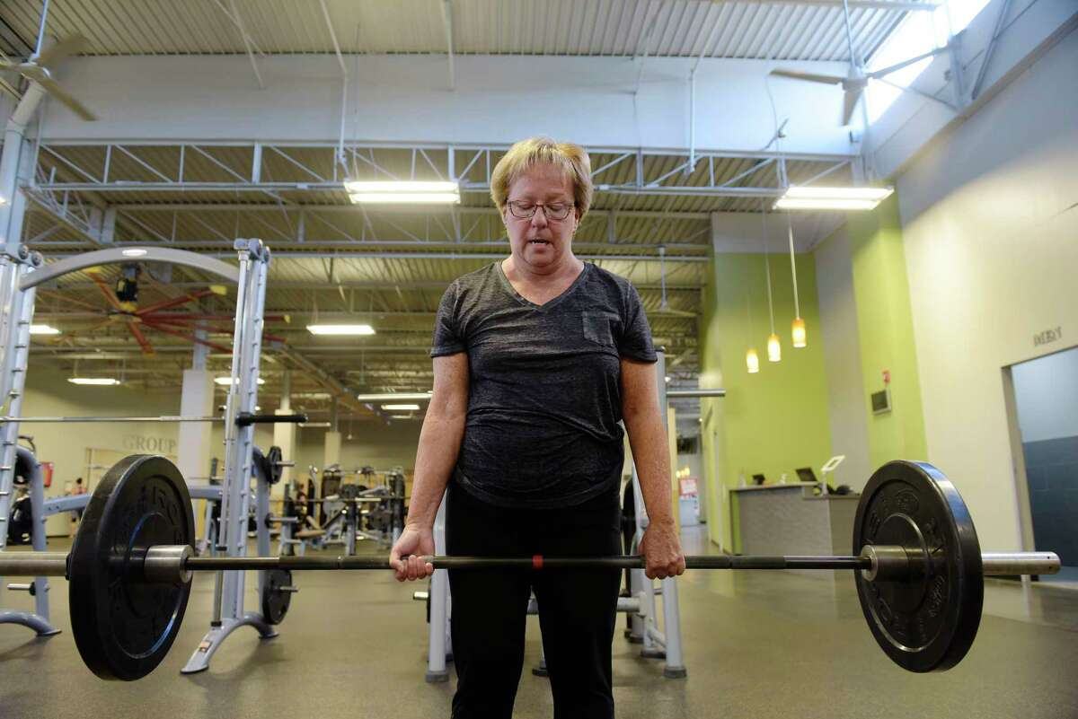 Marilyn Cataldo performs a deadlift as she works out at Best Fitness on Thursday, Aug. 24, 2017, in Albany, N.Y. (Paul Buckowski / Times Union)
