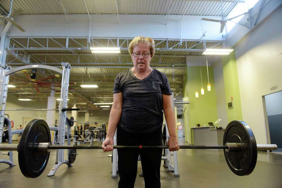 Marilyn Cataldo performs a deadlift as she works out at Best Fitness on Thursday, Aug. 24, 2017, in Albany, N.Y.   (Paul Buckowski / Times Union) Photo: PAUL BUCKOWSKI, Albany Times Union / 20041367A