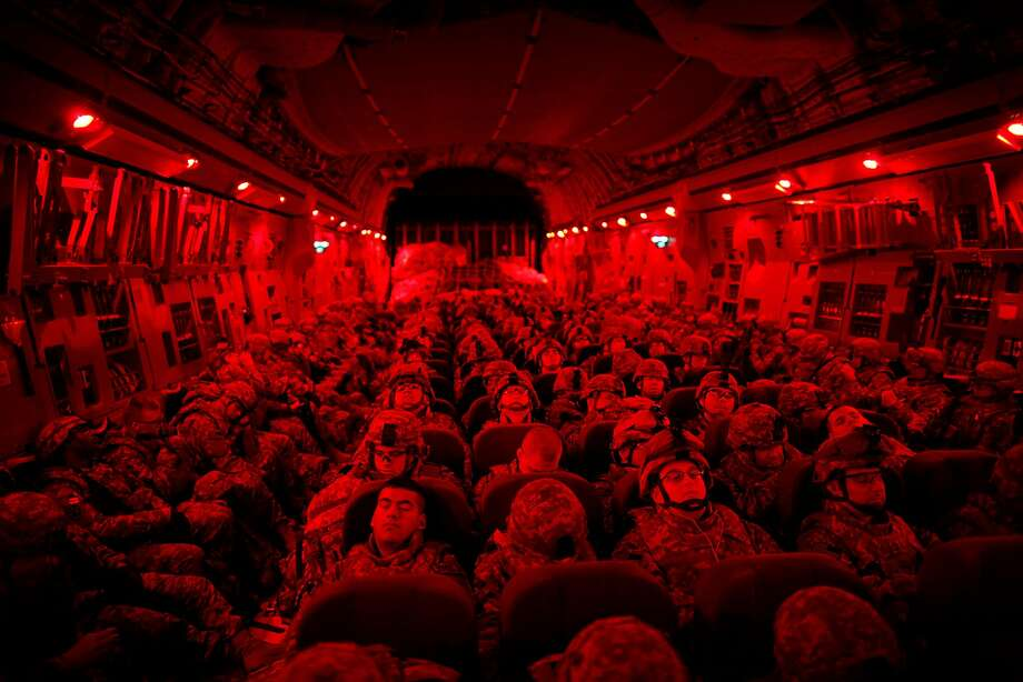 Soldiers in full gear ride on a C-17 military transport from Kyrgyzstan to Afghanistan in 2010. The U.S. war in Afghanistan is now in its 16th year. Photo: DAMON WINTER, NYT