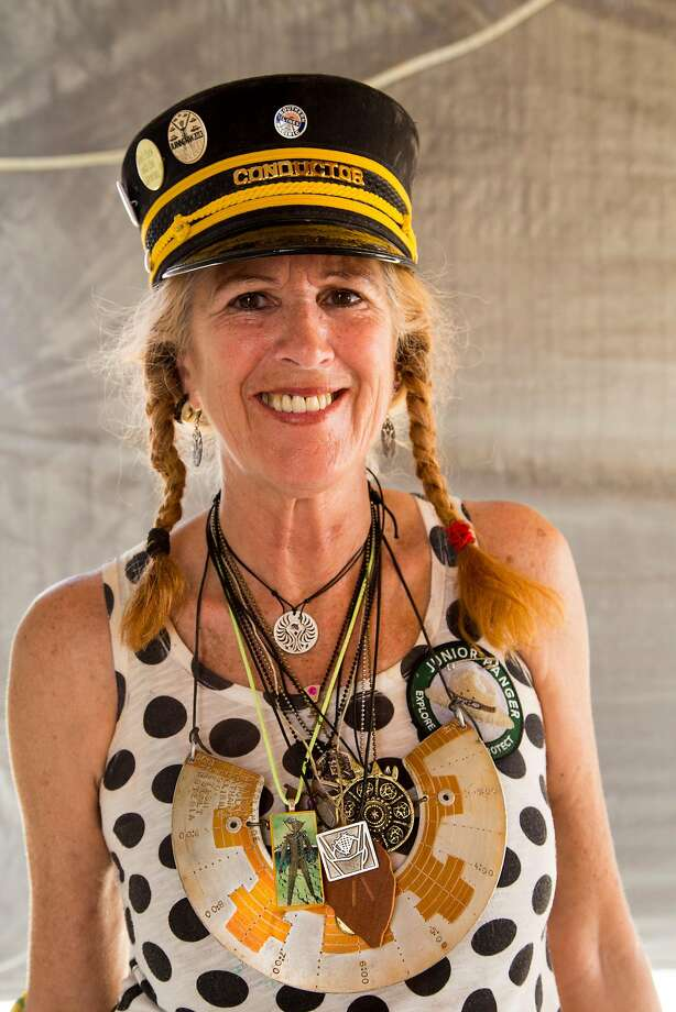 """Christine """"LadyBee"""" Kristen wears her Black Rock City breastplate, by Steve Curl, made from an aluminum hard drive disk, and pendants from other artists. LadyBee is a renowned Burning Man jewelry collector and curator. Photo: George Post"""