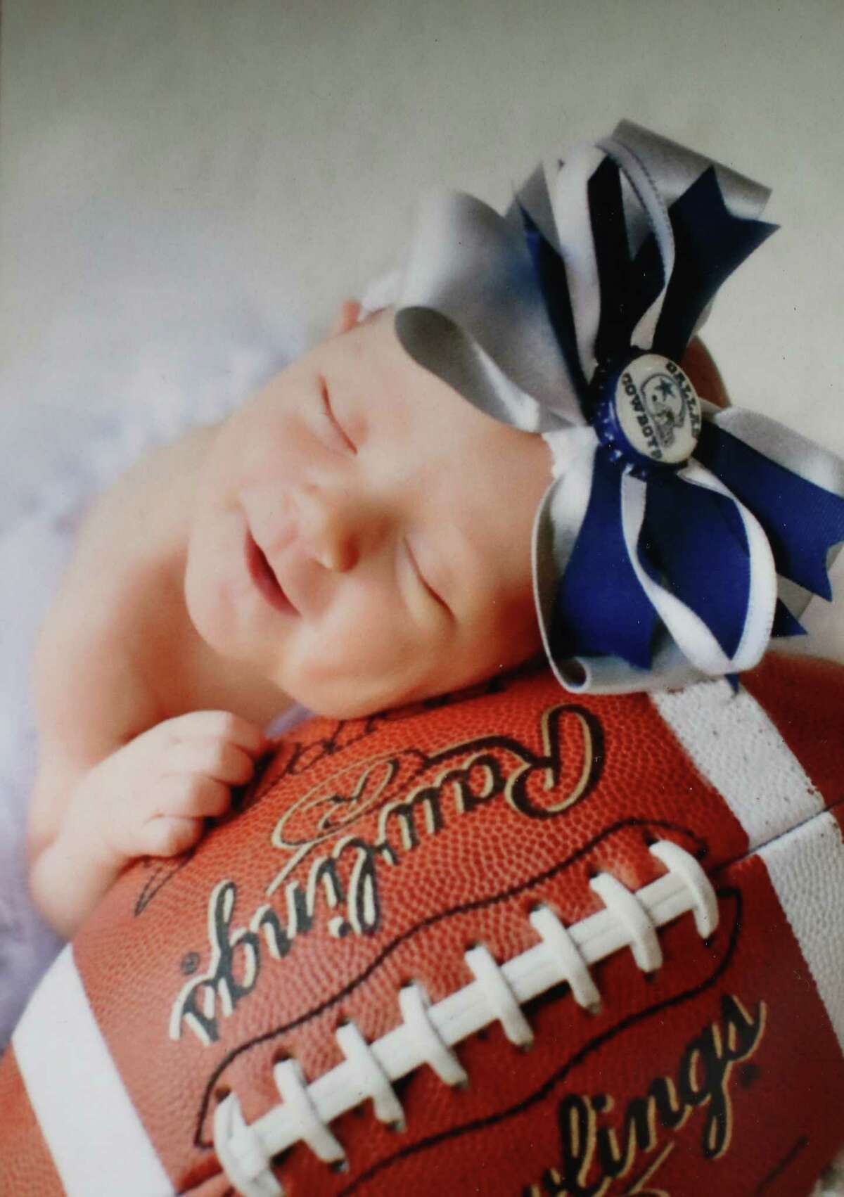 This photo of daughter Sadie adorns the office of Spring High School football coach Trent Miller.
