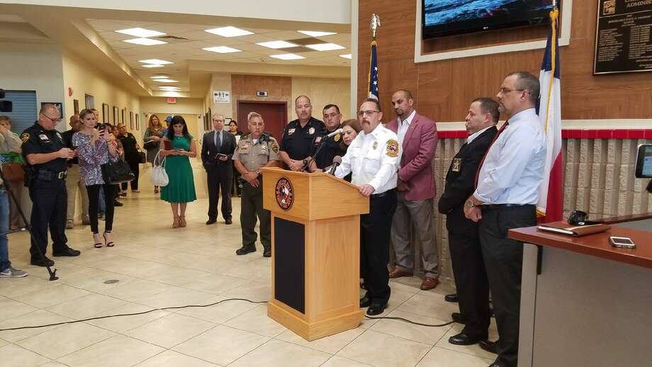 Laredo Fire Department Chief Steve Landin, standing at the lectern, provides an update on the storm during a news conference held Thursday, Aug. 24, 2017 at the Fire Department Administrative Center, 616 E. Del Mar. Photo: Cesar Rodriguez/LMTonline