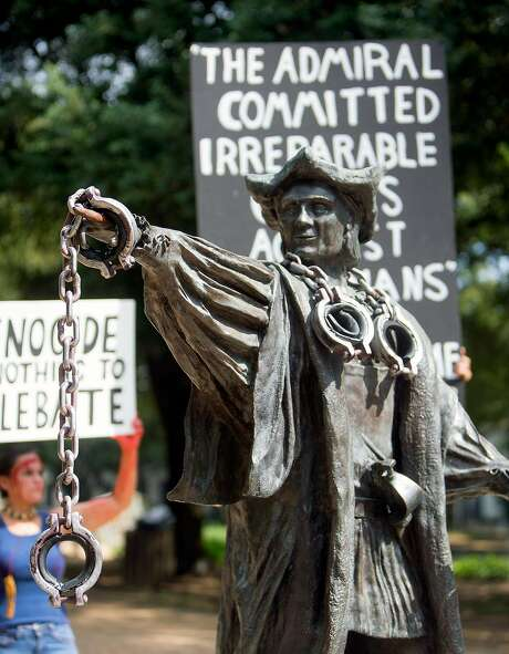 A Columbus statue in Houston was draped with chains to protest Columbus Day. Photo: Cody Duty, Houston Chronicle