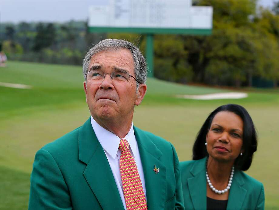 Billy Payne, the chairman of the Augusta National Golf Club, and former Secretary of State Condoleezza Rice, one of Augusta's two first female members, walk the course in 2014. Photo: Curtis Compton, TNS