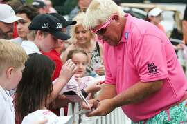 John Daly signs autographs during the Insperity Invitational third round on Sunday, May 8, 2016, at The Woodlands Country Club Tournament Course.