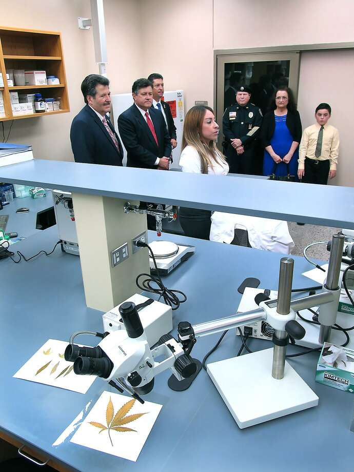 "City, County and State officials along with Webb County District Attorney Chief Investigator Oscar ""O.J."" Hale Sr., and family members were among the first to tour the Texas Department of Public Safety's crime lab in 2015. The governor nixed a DPS plan to impose fees for local law enforcement use of such labs. Photo: CUATE SANTOS / / LAREDO MORNING TIMES"