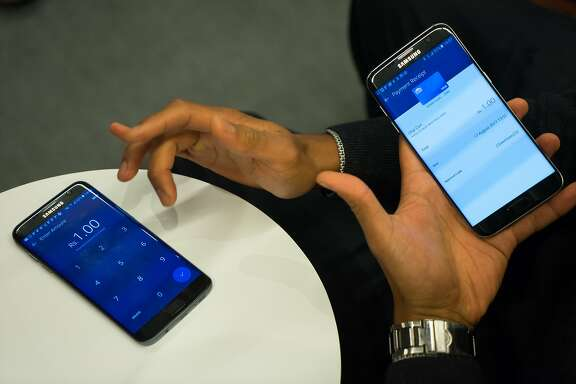 Visa Tech Manager Reuben Alejandro demonstrates Visa's mobile payment applications at Visa International in San Francisco, Calif. on Thursday, Aug. 17, 2017. The company is promoting its vision of a cashless future where mobile devices replace paper money.