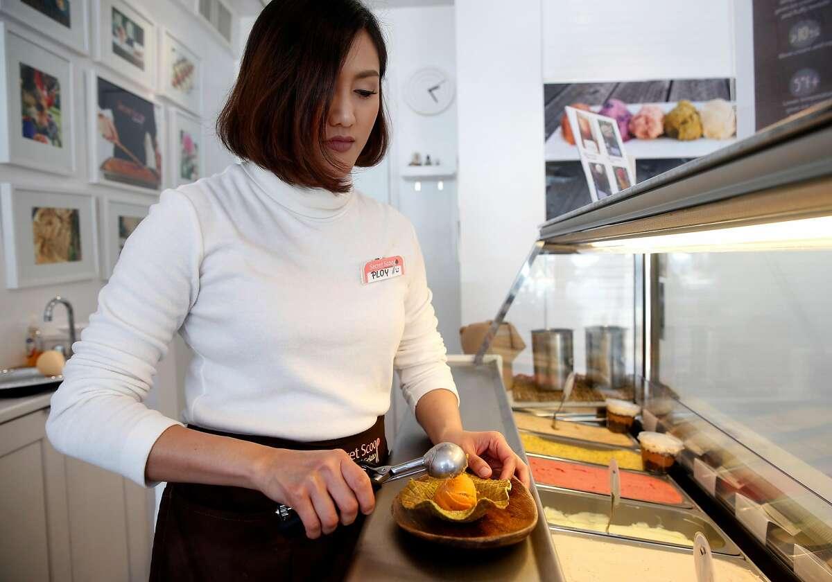 Ploy Damyos assembles an order at the Secret Scoop Thai gelato shop in Berkeley, Calif. on Saturday, Aug. 5, 2017.