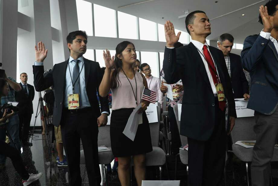 Immigrants take the oath of allegiance to the United States held in the observatory of the One World Trade Center on Aug. 15 in New York City. Studies show that Americans overestimate the number of the foreign born and Muslims in our midst. Photo: John Moore /Getty Images / 2017 Getty Images