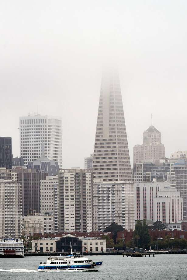 On a typical summer day, fog and clouds shroud the Transamerica Building, but that will change. Photo: Michael Short, Special To The Chronicle