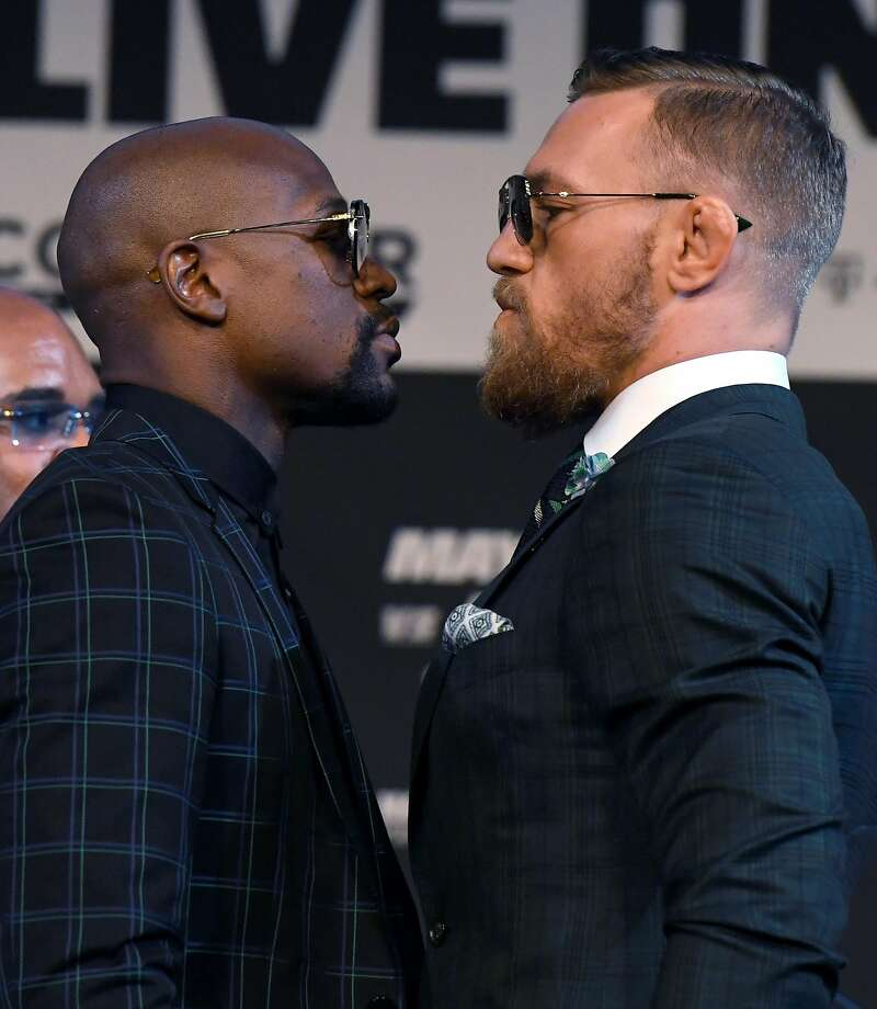 After Saturday night's fight, boxer Floyd Mayweather Jr. (left) should be standing talle over UFC fighter Conor McGregor at T-Mobile Arena Las Vegas. Photo: Ethan Miller, Getty Images
