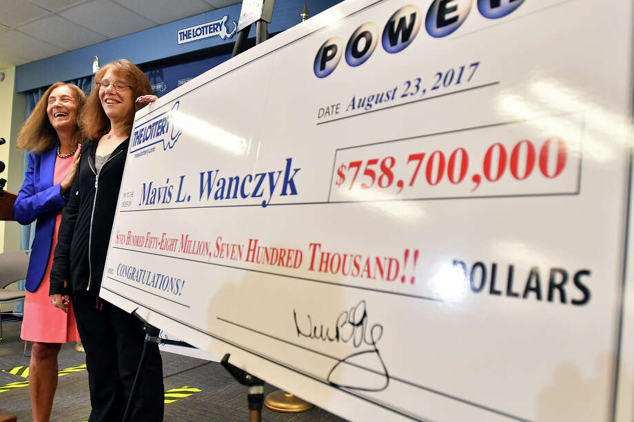 Mavis Wanczyk, of Chicopee, Mass., stands by a poster of her winnings during a news conference where she claimed the $758.7 million Powerball prize at Massachusetts State Lottery headquarters on Thursday. Photo: Josh Reynolds, FRE / FR25426 AP