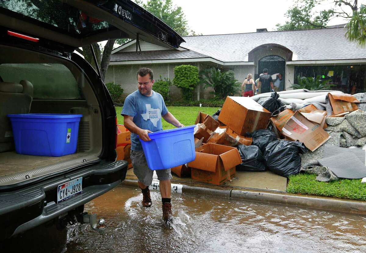 Bill Pennington works to clean up his Meyerland home, Tuesday, April 19, 2016, in Houston. Pennington said the family was finally about 70% done with their remodel since the Memorial Day flood last year brought 27 inches of rain into the house. Monday's flood brought 16 inches. The family had just bought new appliances three weeks ago. ( Mark Mulligan / Houston Chronicle )