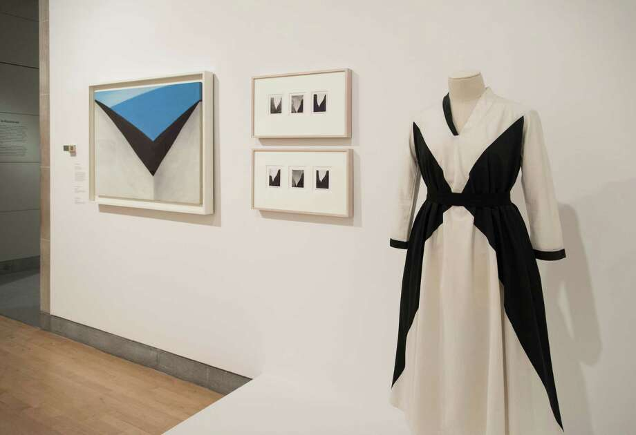 "Georgia O'Keeffe's clothing, positioned near artwork, featured in the recent ""Living Modern"" installation at the Brooklyn Museum. (Provided, Jonathan Dorado, Brooklyn Museum)"