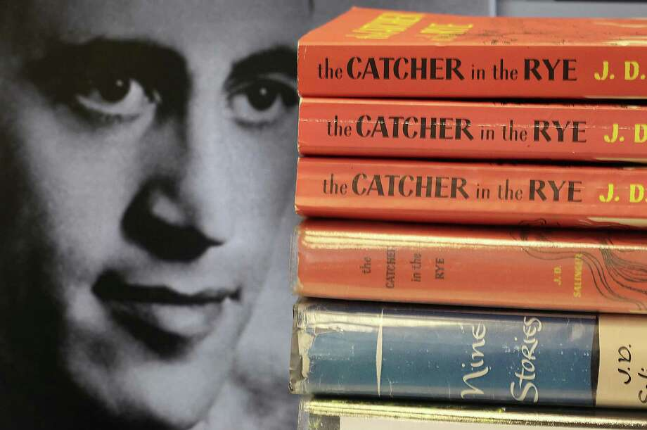 """Copies of J.D. Salinger's classic novel """"The Catcher in the Rye"""" as well as his volume of short stories called """"Nine Stories"""" are seen at the Orange Public Library in Orange Village, Ohio on Thursday, Jan. 28, 2010. Salinger, the legendary author, youth hero and fugitive from fame whose """"The Catcher in the Rye"""" shocked and inspired a world he increasingly shunned, died Wednesday at the age of 91. At left is a 1951 photo of the author. (AP Photo/Amy Sancetta) Photo: Amy Sancetta / AP / AP"""