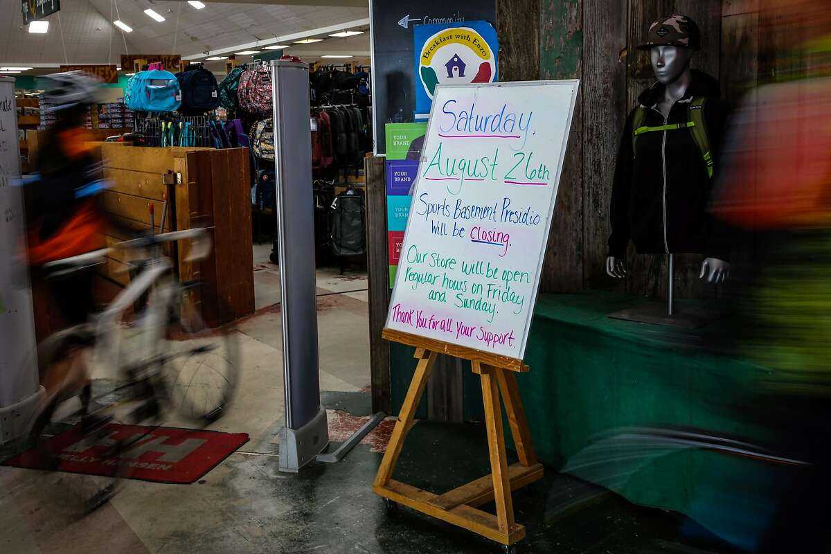 A sign declaring that Sports Basement Presidio will close on Saturday is seen at the entrance to the store ahead of Saturday's Patriot Prayer rally in San Francisco, Calif., on Thursday, Aug. 24, 2017.
