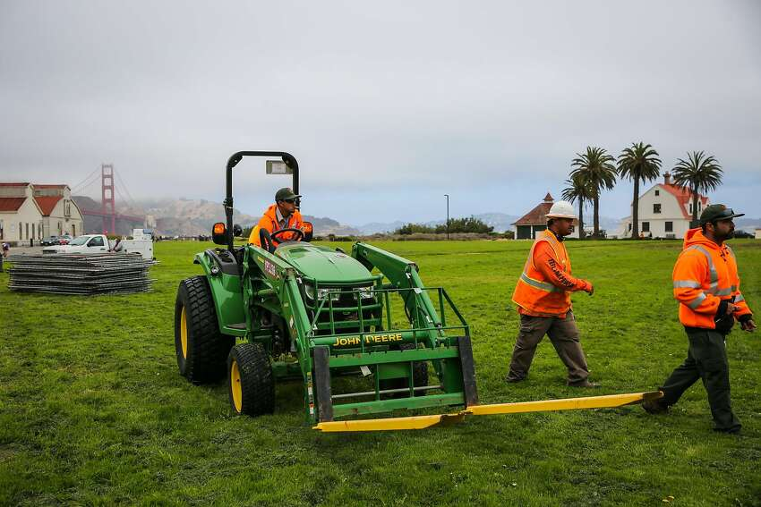 Workers Mario T. (center) and Park and Rec workers help unload chain link fences at Crissy Field ahead of Saturday's Patriot Prayer rally in San Francisco, Calif., on Thursday, Aug. 24, 2017.