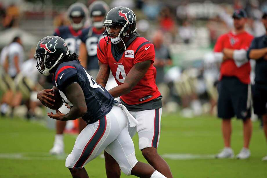 Houston Texans quarterback Deshaun Watson (4) hands off to running back Dare Ogunbowale (44) during a joint practice with the New Orleans Saints at the Saints NFL football training facility in Metairie, La., Thursday, Aug. 24, 2017. (AP Photo/Gerald Herbert) Photo: Gerald Herbert, STF / Copyright 2017 The Associated Press. All rights reserved.