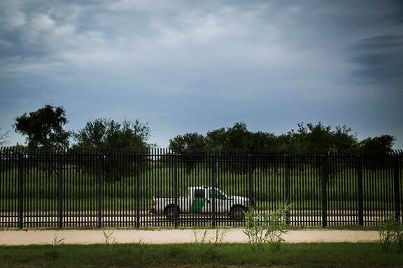 U.S Customs and Border Protection patrol vehicle is parked by the border fence, Tuesday, Aug. 15, 2017, in Del Rio.