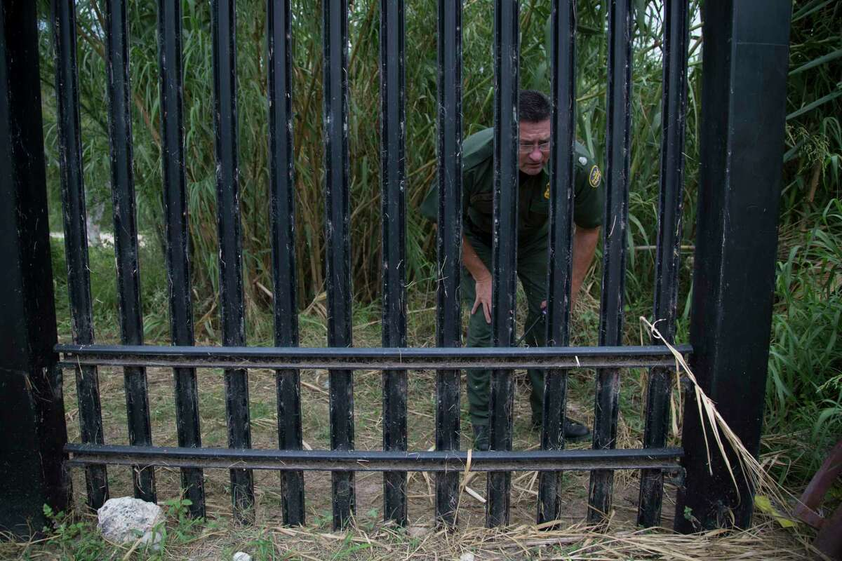 U.S Customs and Border Protection Operations Officer David Vera inspects the fence that protects the border area of Del Rio, as part of the responsibilities of field agents during their shifts, Wednesday, Aug. 16, 2017. Zero-tolerance prosecutions of migrants, known as Operation Streamline, began in this border town in 2005.