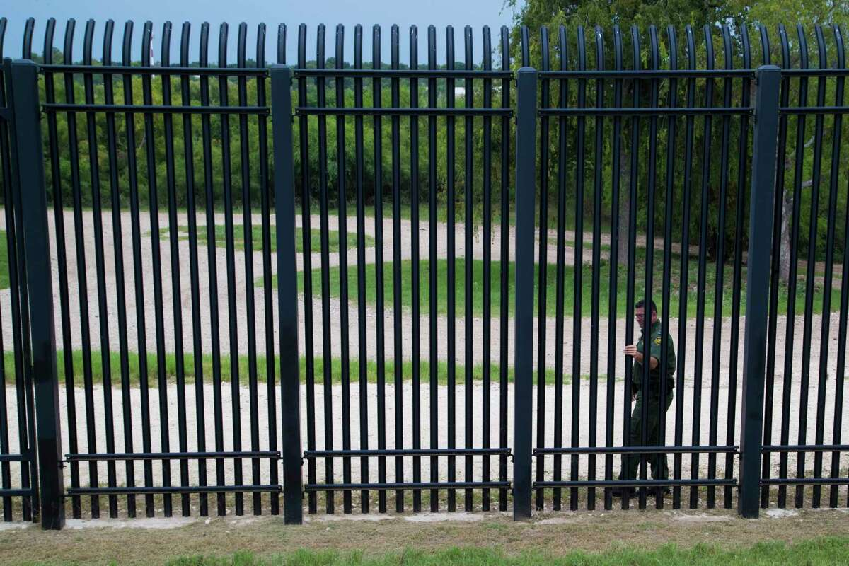 U.S Customs and Border Protection Operations Officer David Vera inspects the fence that protects the border area of Del Rio, as part of the responsibilities of field agents during their shifts, Wednesday, Aug. 16, 2017.