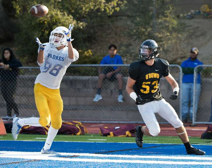 Serra's Anthony Ovalle intercepts a pass intended to Bishop O'Dowd's Quinn Brinnon on Friday, Aug. 18, 2017 in San Mateo, CA.