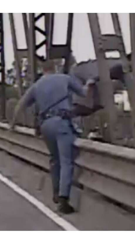 Washington State Trooper Yaroslav Holodkovsaved a man's life by snatching him off the side of a bridge as he attempted to jump off it. Photo: Washington State Patrol