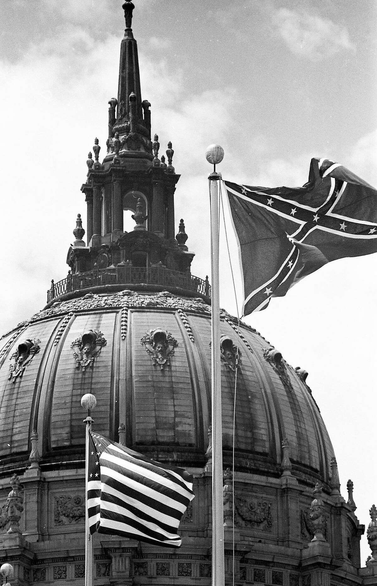 June 16, 1964: A confederate flag flies among a group of flags in Civic Center Flags in front of City Hall. The flag remained after initial protests, but was eventually removed.