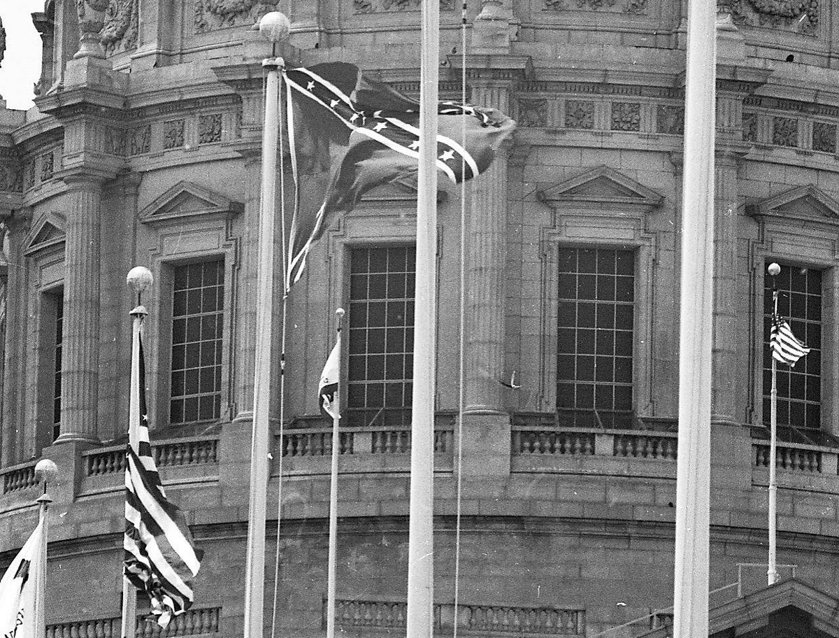 A confederate flag flies among a group of flags in Civic Center Flags in front of City Hall on June 16, 1964. The flag remained after initial protests, but was eventually removed.